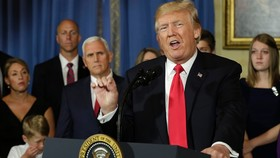 """US President Donald Trump delivers s statement on healthcare in front of alleged """"victims of Obamacare"""" at the White House in Washington on July 24. — AFP/VNS"""