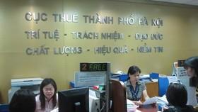 Hanoi makes public 144 enterprises & projects owing tax debts  