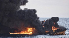 This handout picture from China's Transport Ministry taken and released on January 13, 2018 shows smoke and flames coming from the burning oil tanker. — AFP/VNA Photo