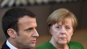 Hosting Merkel, Macron gets chance to push EU business