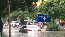 Rains flood Hanoi's many streets