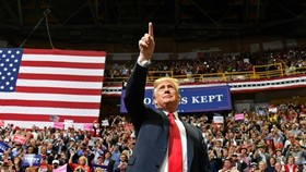 In a hard-driving series of rallies around the country, President Donald Trump has put himself at the centre of the US midterm campaign. — AFP/VNS