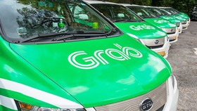 Thai bank to invest $50 million in ride-hailing firm Grab