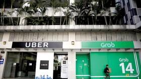 Grab và Uber bị phạt gần 10 triệu USD tại Singapore