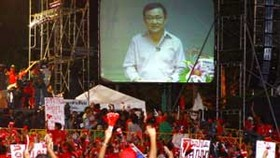 Thai PM hits back at Thaksin rallying call
