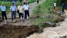 Northern floods kill at least 16, 15 missing