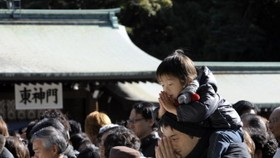 Japan emperor offers sympathy for public's money woes