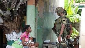 Jamaica slum seethes as kingpin eludes assault