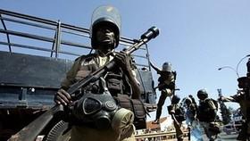 Twin blasts kill at least 64 in Ugandan capital