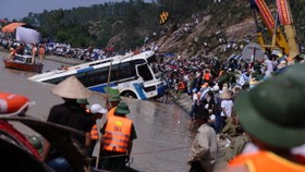 Swept-away bus recovered, 14 bodies found