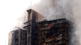 Shanghai fire toll at 53 as relatives search for the missing