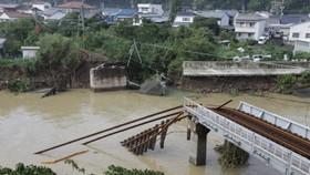 Grim search after 25 die in Japan typhoon