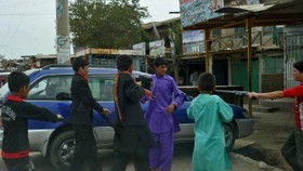 Afghan suicide attack on NATO convoy kills two