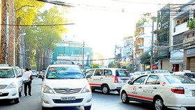 Taxi fares slashed by VND500
