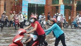 Heavy rain triggers flooding in HCMC
