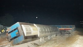 One person killed as train hits truck