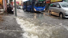 Drenching rain submerges slew of streets in HCMC