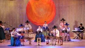 Korean, Vietnamese folk music performance in city