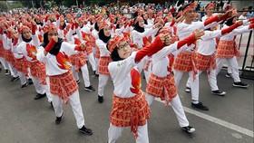 Nước chủ nhà muốn dùng điệu nhảy truyền thống tạo không khí hào hứng cho sự kiện thể thao sắp tới. Ảnh: AAP