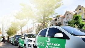 Grab cars (Photo: VNA)