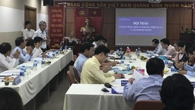 Delegates at a meeting in HCM City discuss solutions to develop the city's key industrial products. (Photo: VNA)