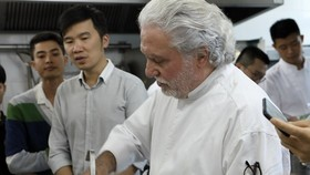 Two-star Michelin chef Alain Dutournier conducts a cooking class in KOTO vocational training center.