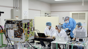 Vietnamese engineers work to develop MicroDragon satellite.