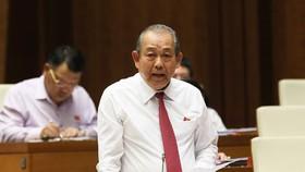 Phó Thủ tướng Thường trực Trương Hòa Bình trả lời chất vấn. Ảnh: VIỆT CHUNG