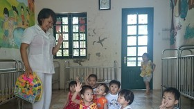At a child protection shelter in Vietnam (Photo: VNA)