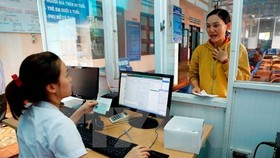 Health care facilities are required to apply electronic health care record before 2028. (Photo: VNA)