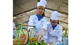 Young cooks are displaying their dishes in a tourism festival in Ho Chi Minh City