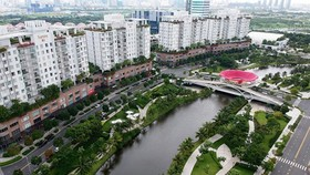An ecological lake to store water in a new residential area in District 2 of HCMC. (Photo: SGGP)