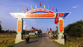 The path leads to Dong BInh Commune in Can Tho City ( Photo: SGGP)