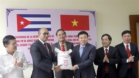 A ceremony was held at the headquarters of the Cuban Ministry of Foreign Trade and Investment (MINCEX) on Monday to mark the delivery of 5,000 tones of Vietnamese rice to Cuba. — Photo daidoanket.vn