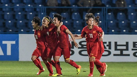 Vietnamese women celebrate their victory over Thailand at the Asian Games in August 2018 (Photo: VNA)