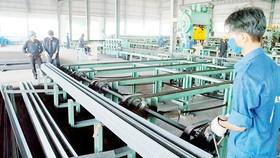 Sản xuất thép xuất khẩu tại một doanh nghiệp. Ảnh: CAO THĂNG