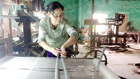 Ngày càng ít người làng lụa Mã Châu theo nghề truyền thống của quê hương