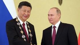 中俄兩國元首互致新年賀電。習近平:回首2017年,中俄全面戰略協作夥伴關係在高水準上取得新的重要發展。(示意圖源:新華網)