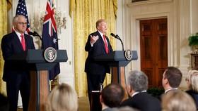美總統特朗普(右)和澳總理特恩布爾在白宮舉行記者會。(圖源:新華網)