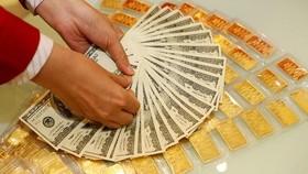 金價與美元匯率下降。(示意圖源:互聯網)