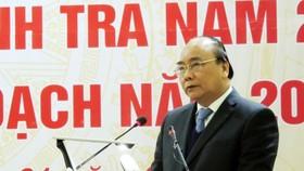 政府總理阮春福在會議上發表講話。(圖源:明范)