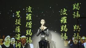 """日本京都市的高台寺為了向普羅大眾宏揚佛法,近日與大阪大學學者合作,在寺內設置人工智能(AI)機械人觀音""""Minder""""。(圖源:IC)"""