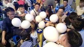 從今以後,使用笑氣球將被列入河內禁止行為名單內。(圖源:明康)
