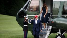 6月7日,美國總統特朗普(中)抵達華盛頓白宮。(圖源:新華社)