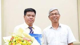 新任市交通運輸廳副廳長裴和安(左)。(圖源:自忠)