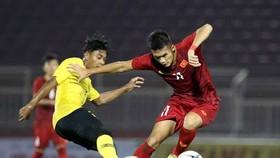 越南隊(紅衣)-馬來西亞隊比賽一瞥。(圖源:互聯網)