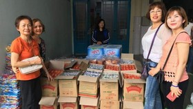 """平西市場商販於日前組團前往第一兒童醫院舉辦""""情滿中秋""""活動。"""