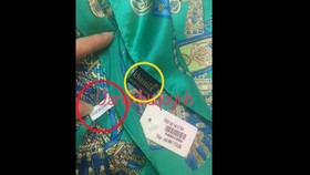 A Khaisilk scarf bearing both 'made in China' and 'made in Vietnam' labels