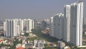 Buildings along Nguyen Huu Tho street in District 7 and Nha Be, HCMC (Photo: SGGP)