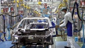 The Ministry of Industry and Trade has asked the Ministry of Finance to remove the special consumption tax for locally-manufactured auto parts. (Photo: vietnambiz.vn)